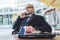 successful elegant fashionable businessman on the phone